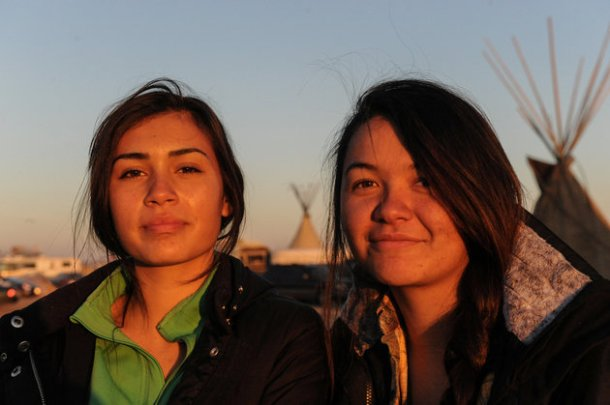 Waskoness Pitawanakwat from the Ojibwe tribe and Tea McGinnis from the Hupa tribe pose for a photograph in an encampment during a protest against plans to pass the Dakota Access pipeline near the Standing Rock Indian Reservation, North Dacota